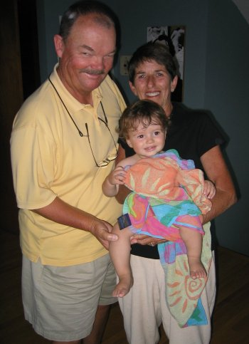 Grandma and Grandpa with their lil' swimmer