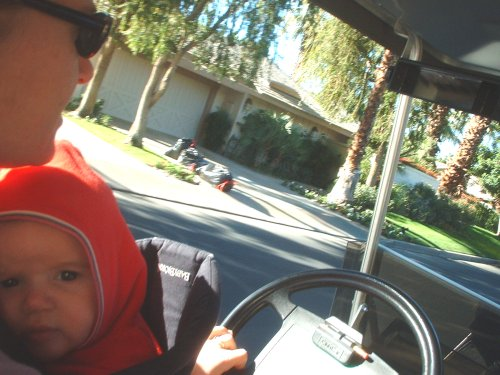 Molli and Sean driving the golf cart