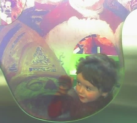 Sean poking his head through an Ensor painting in the family room at the Getty