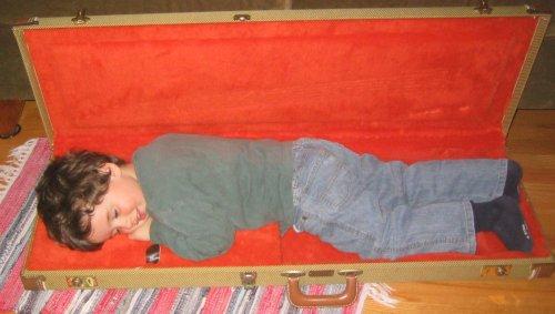Sean in a guitar case