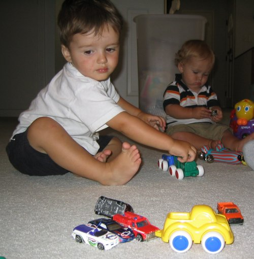 Sean and Jackson play with cars