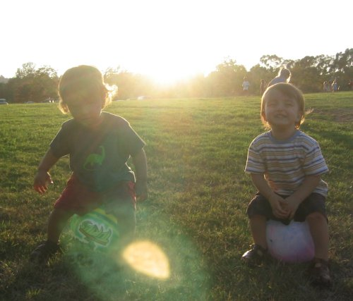 Sean and Xander playing with balls at the Autry