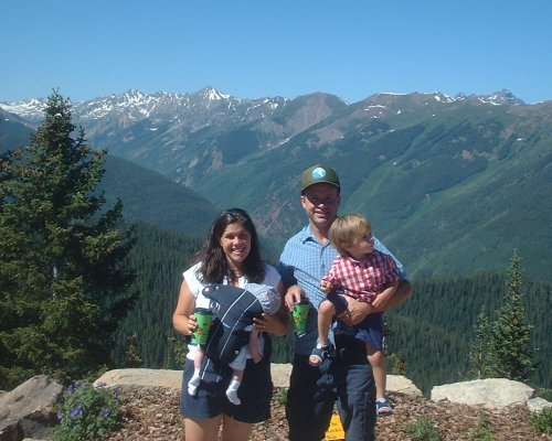 The Parkers on top of the mountain over Aspen